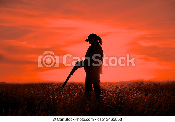 Woman Hunter in Sunset - csp13465858