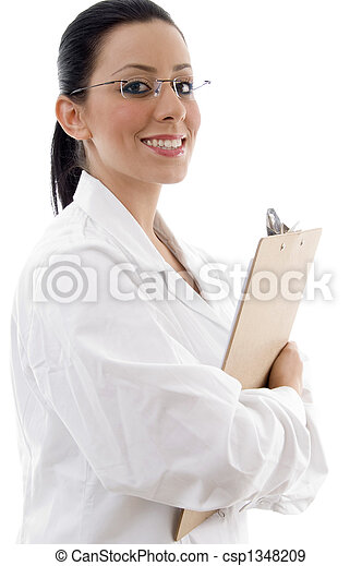 side view of smiling doctor holding writing pad - csp1348209