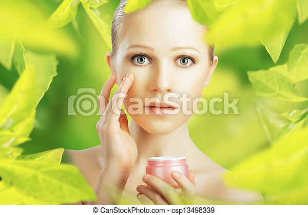beauty woman with cream and  natural skin care in green - csp13498339