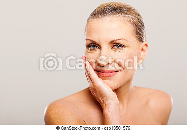 modern woman with hand on her face - csp13501579