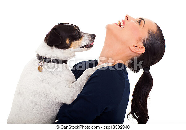 young woman with her dog playing - csp13502340