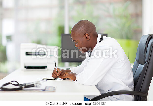 african medical doctor writing reports - csp13506881