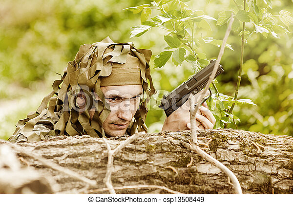 Young Camouflaged military man - csp13508449