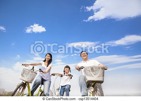 happy family riding bicycle with cloud background - csp13514404