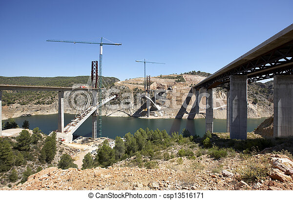 Bridges under construction - csp13516171