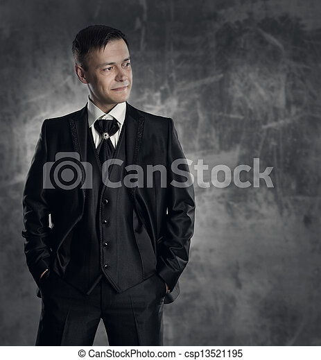 Handsome man in black suit. Wedding groom fashion. Gray background. - csp13521195
