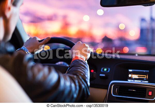 Driving a car at night -man driving his modern car at night - csp13530019