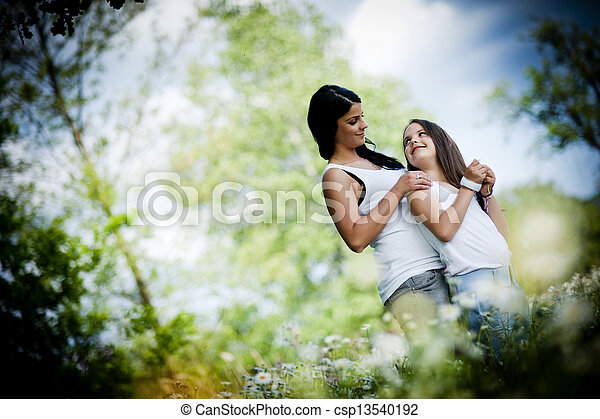 mother and daughter in the park - csp13540192