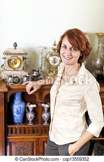 Woman with antique collection - csp13559352