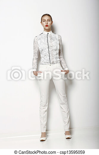 High Fashion. Trendy Woman in White Breeches in Graceful Pose. Spring Time Collection - csp13595059