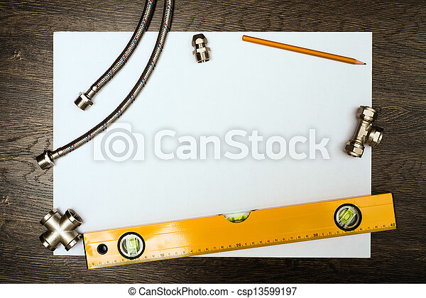 plumbing tools on a white sheet of paper - csp13599197