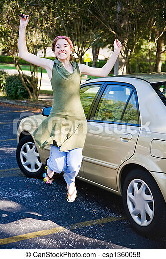 Teen Driver Jumping for Joy - csp1360058