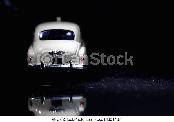 White vintage car in spot