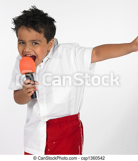 boy singing into his mike - csp1360542