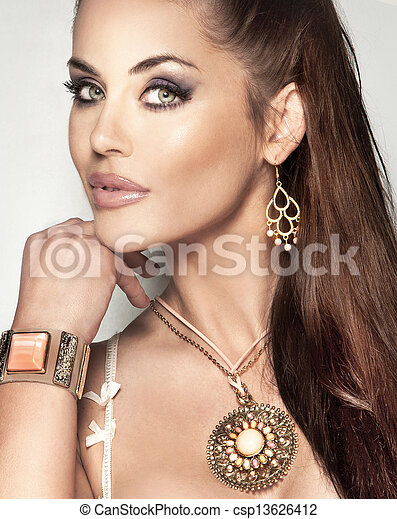 Portrait of fashionable beautiful woman with long brunette hair and amazing jewellery. - csp13626412