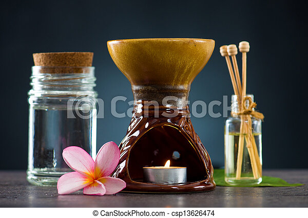 tropical frangipani spa health treatment with aroma therapy and hot stones, shot with ambient lights   - csp13626474