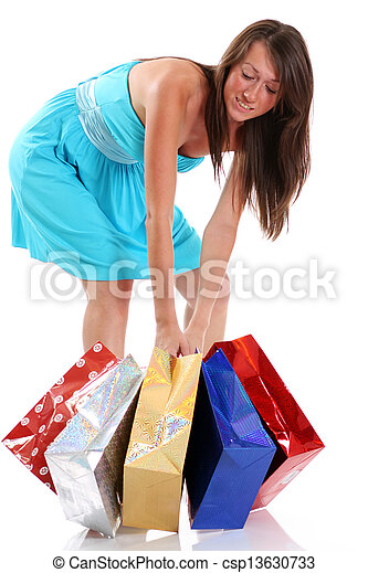 Happy young adult woman with colored bags  - csp13630733