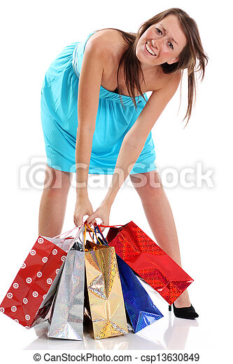 Happy young adult woman with colored bags  - csp13630849