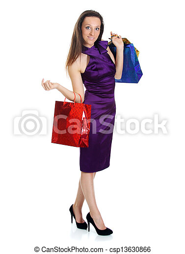 Happy young adult woman with colored bags  - csp13630866