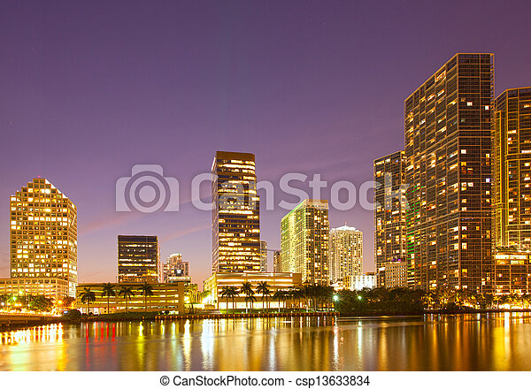 City of Miami Florida, night skyline. Cityscape of residential and business buildings lit by bright lights after sunset - csp13633834