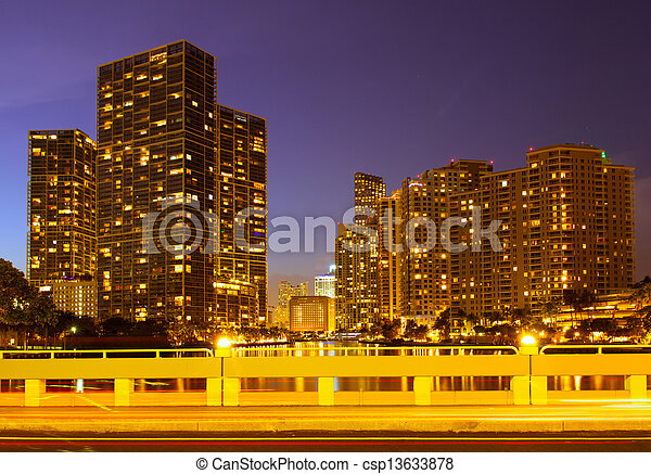 City of Miami Florida, night skyline. Cityscape of residential and business buildings lit by bright lights after sunset - csp13633878
