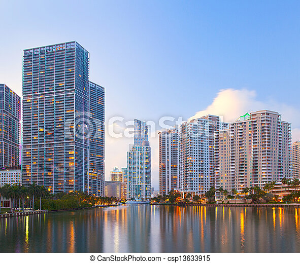 Miami Florida, Brickell and downtown financial buildings over miami River on a beautiful summer day before sunset - csp13633915