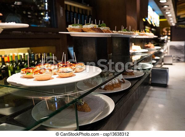 Traditional basque pinchos on a plate in restaurant - csp13638312