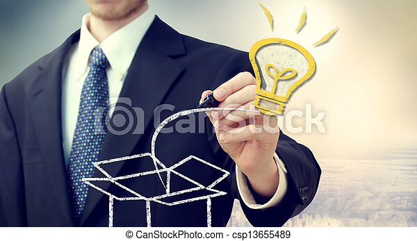 Business man with idea light bulb coming 'out of the box' - csp13655489