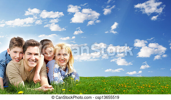 Happy family relaxing at the park. - csp13655519