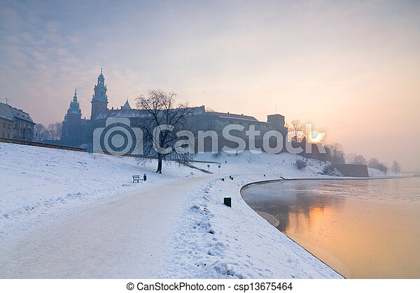 Historic royal Wawel Castle in Cracow, Poland, with frozen Vistula river in winter.  - csp13675464