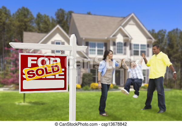 Hispanic Family in Front of Sold Real Estate Sign, House - csp13678842