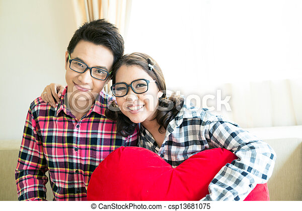 Happy Young adult Couples in living room - csp13681075