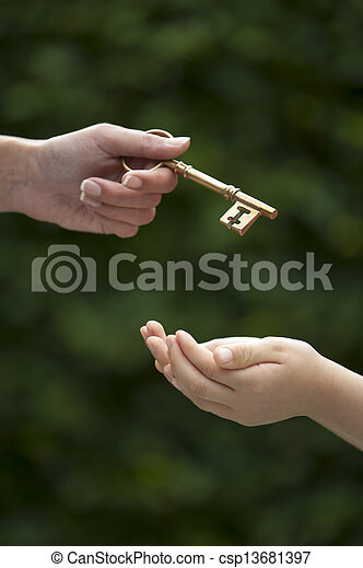 adult hands key to child - csp13681397