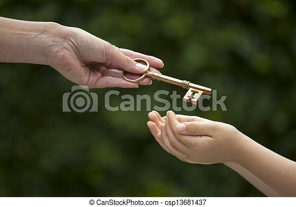 adult hands key to child - csp13681437
