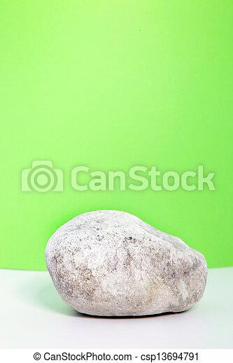 Single waterworn smooth white rock