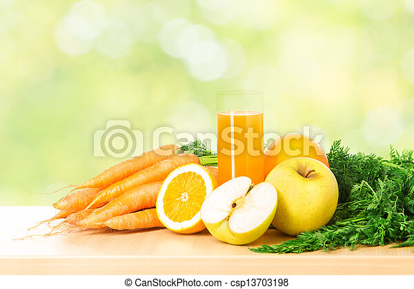 Fruit and vegetable juice in glass over green fresh background. Healthy vitamin food diet concept. - csp13703198