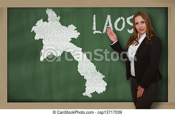 Teacher showing map of laos on blackboard - csp13717039