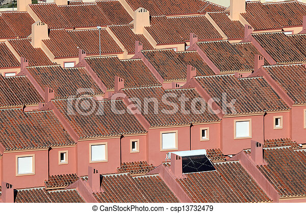 Roofs of red residential houses in a urbanization in Spain - csp13732479