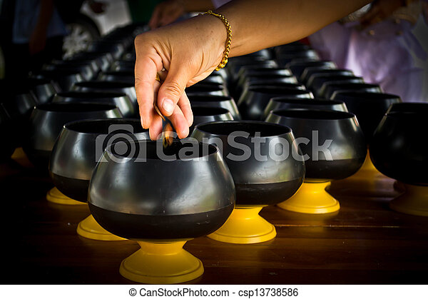 Women coin operated Down in alms bowl, successive in job the way religion Buddhist - csp13738586
