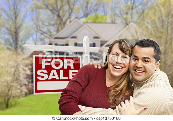 Couple in Front of For Sale Sign and House - csp13750168