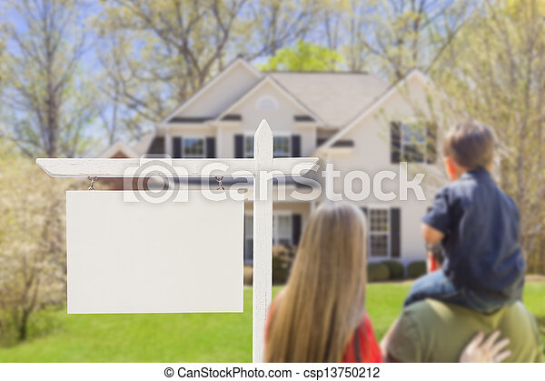 Family in Front of Blank Real Estate Sign and House - csp13750212