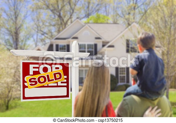 Family Facing Sold For Sale Real Estate Sign and House - csp13750215
