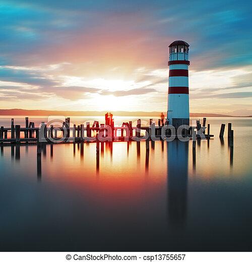 Ocean lighthouse sunset  - csp13755657