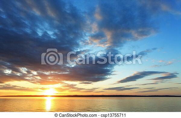 Sunset over ocean - csp13755711