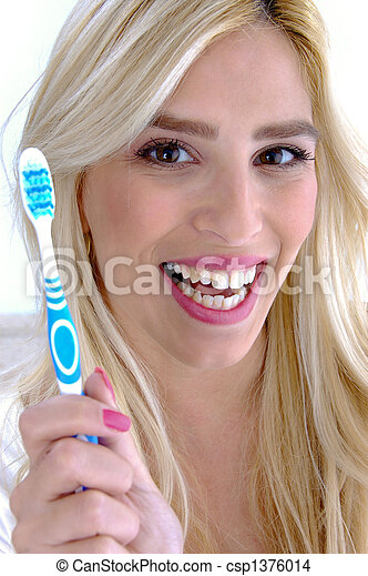 front view of happy female conscious of dental health - csp1376014