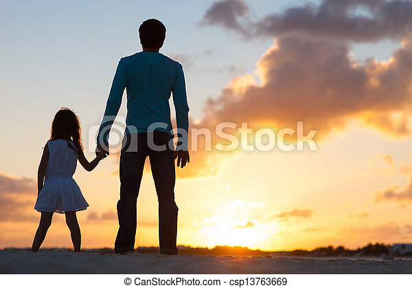 Family at sunset - csp13763669