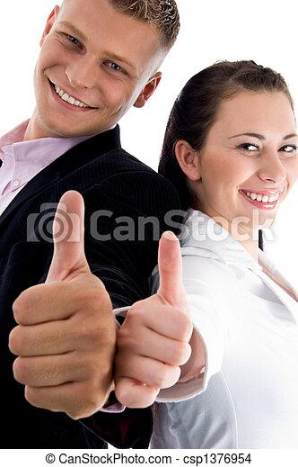 pleased couple wishing goodluck - csp1376954