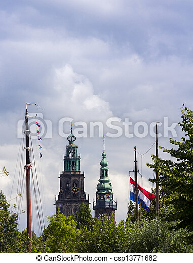 Dutch cityscape with church towers and boat masts - csp13771682