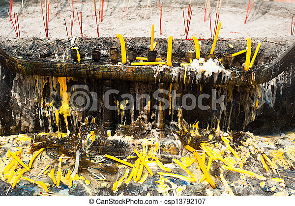 Candles and aroma incense sticks for religion offering ceremony in buddhist temple. Wat Phra Yai. Koh Samui island, Thailand - csp13792107
