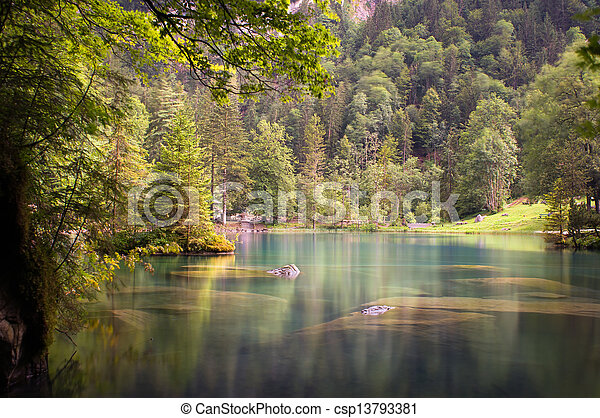 Lake in the woods - csp13793381